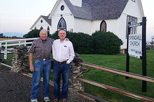 Fathers in the Field - Chuck and John Smithbaker in front of their Legacy Campus