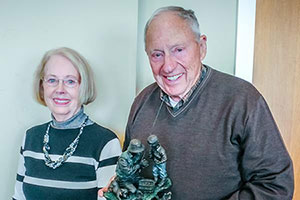 Fathers in the Field - Chuck and Marcia Raches receiving the Defender of the Fatherless honor