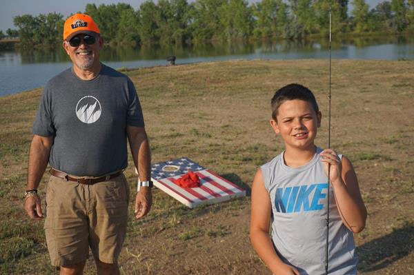 Mentor Father Mark and Field Buddy Ethan fishing