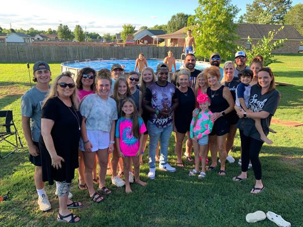 Photo of David, Isaiah, family and friends